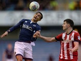 Millwall's Tim Cahill in action with Brentford's John Egan on March 10, 2018