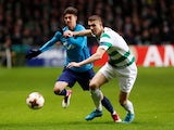 Zenit St Petersburg's Emiliano Rigoni in action with Celtic's Jozo Simunovic on February 15, 2018