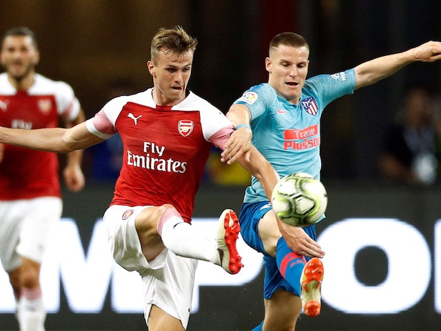 Rob Holding and Kevin Gameiro in action during the pre-season friendly between Arsenal and Atletico Madrid on July 26, 2018