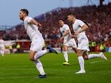 Burnley striker Sam Vokes celebrates after equalising his side in their Europa League qualifier with Aberdeen
