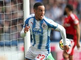 Huddersfield Town's Tom Ince celebrates scoring on April 14, 2018