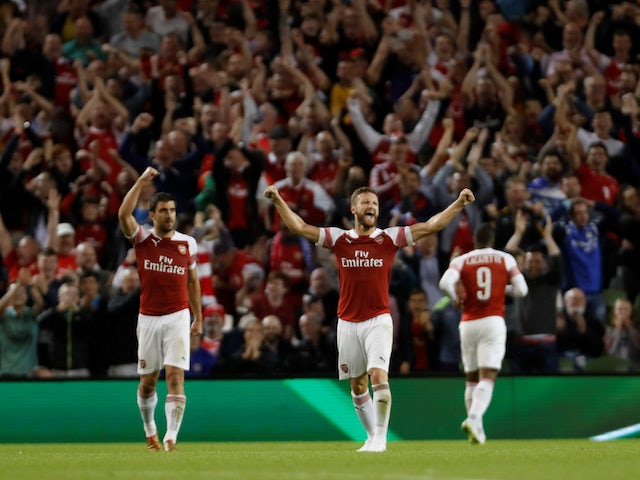 Arsenal players celebrate the equaliser during the pre-season friendly between Chelsea and Arsenal on August 1, 2018