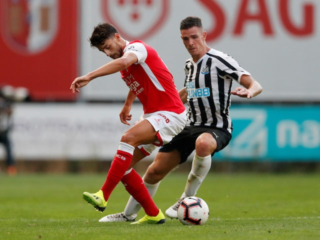 Ciaran Clark and Xadas in action during the pre-season friendly between Braga and Newcastle United on August 1, 2018