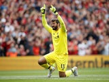 Alisson Becker reacts during the Premier League game between Liverpool and West Ham United on August 12, 2018