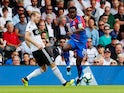 Jeffrey Schlupp puts Andre Schurrle under pressure during the Premier League clash between Fulham and Crystal Palace on August 11, 2018
