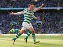 Callum McGregor celebrates his opener during the Champions League qualifying game between Celtic and AEK Athens on August 8, 2018
