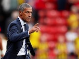 Brighton & Hove Albion manager Chris Hughton watches on during his side's Premier League clash with Watford on August 11, 2018