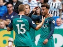 Tottenham Hotspur midfielder Dele Alli celebrates with Harry Kane and Eric Dier after scoring in their Premier League clash with Newcastle United on August 11, 2018