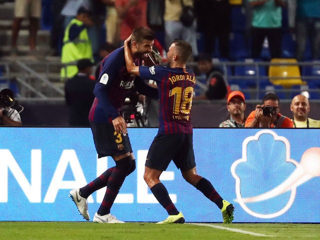 Gerard Pique celebrates his equaliser during the Supercopa de Espana between Sevilla and Barcelona on August 12, 2018