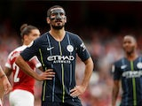 Ilkay Gundogan poses with his face mask during the Premier League game between Arsenal and Manchester City on August 12, 2018