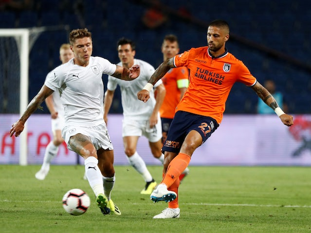Jeff Hendrick and Manuel da Costa in action during the Europa League quarter-final game between Istanbul Basaksehir and Burnley on August 9, 2018