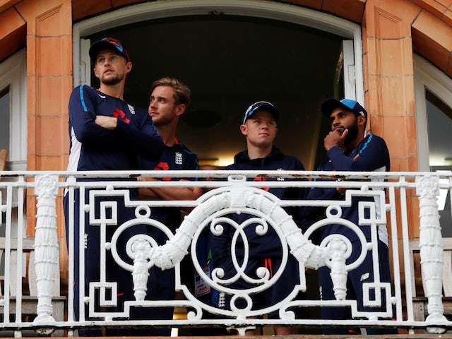 Joe Root, Stuart Broad, Adil Rashid and Ollie Pope observe as rain washes out the first day of the second Test between England and India at Lord's on August 9, 2018