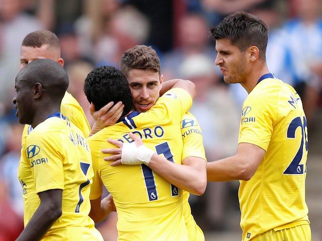Chelsea midfielder Jorginho celebrates scoring during his side's Premier League clash with Huddersfield Town on August 11, 2018