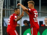 Joshua Kimmich and Thiago celebrate the opener during the German Super Cup game between Eintracht Frankfurt and Bayern Munich on August 12, 2018