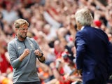 Jurgen Klopp celebrates in Manuel Pellegrini's face during the Premier League game between Liverpool and West Ham United on August 12, 2018