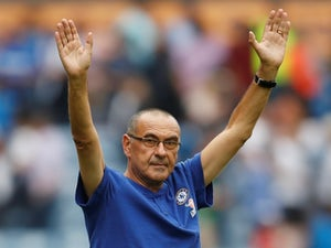 Chelsea manager Maurizio Sarri celebrates after watching his side beat Huddersfield Town on August 11, 2018