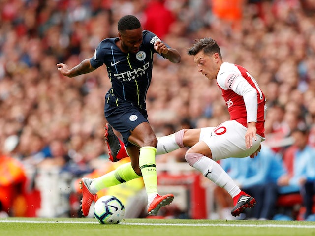 Mesut Ozil and Raheem Sterling in action during the Premier League game between Arsenal and Manchester City on August 12, 2018