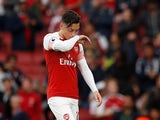 Mesut Ozil wipes his nose on his shirt during the Premier League game between Arsenal and Manchester City on August 12, 2018