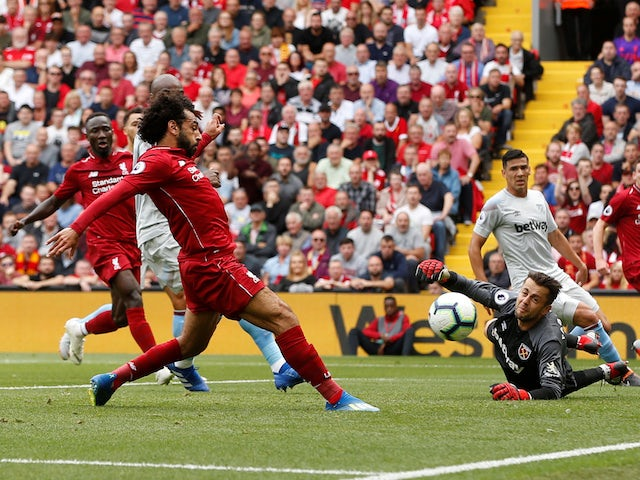 Mohamed Salah scores the opener during the Premier League game between Liverpool and West Ham United on August 12, 2018