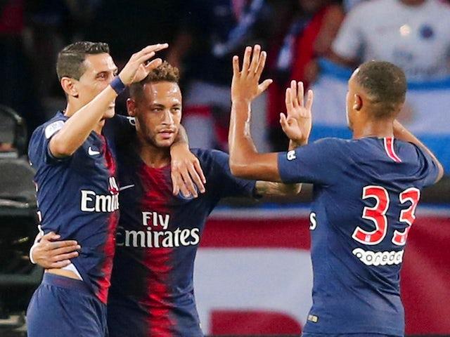 Neymar celebrates scoring the opener during the Ligue 1 game between Paris Saint-Germain and Caen on August 12, 2018