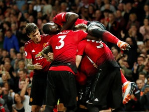 Paul Pogba is mobbed by his Manchester United teammates after scoring against Leicester City on August 8, 2018