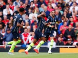 Raheem Sterling celebrates scoring during the Premier League game between Arsenal and Manchester City on August 12, 2018