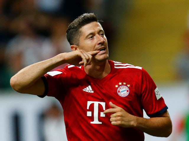 Robert Lewandowski celebrates scoring the third during the German Super Cup game between Eintracht Frankfurt and Bayern Munich on August 12, 2018