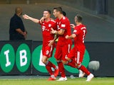 Robert Lewandowski celebrates scoring the second during the German Super Cup game between Eintracht Frankfurt and Bayern Munich on August 12, 2018