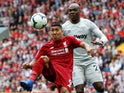 Roberto Firmino and Angelo Ogbonna in action during the Premier League game between Liverpool and West Ham United on August 12, 2018