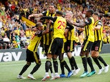 Watford players celebrate Roberto Pereyra's opening goal during their Premier League clash with Brighton on August 11, 2018