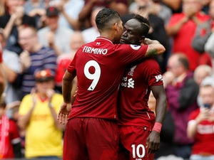 Sadio Mane celebrates with Roberto Firmino after scoring during the Premier League game between Liverpool and West Ham United on August 12, 2018