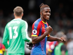 Crystal Palace winger Wilfried Zaha celebrates after scoring during his side's Premier League clash with Fulham on August 11, 2018