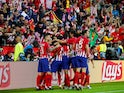 Atletico Madrid striker Diego Costa celebrates with teammates after opening the scoring in the UEFA Super Cup match against Real Madrid on August 15, 2018
