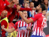 Atletico Madrid striker Diego Costa celebrates after opening the scoring in the UEFA Super Cup match against Real Madrid on August 15, 2018