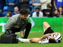 Newcastle United's Javier Manquillo receives treatment from medical staff after sustaining an injury during the match against Cardiff City on August 18, 2018