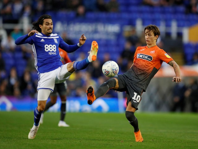 Birmingham City's Jota challenges Swansea City's Bersant Celina for the ball on August 17, 2018