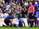Cardiff City's Junior Hoilett receives treatment from medical staff after sustaining an injury in the match against Newcastle United as referee Craig Pawson looks on on August 18, 2018