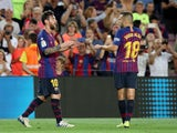Lionel Messi celebrates with Jordi Alba after scoring Barcelona's opening goal against Alaves on August 18, 2018