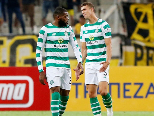 Olivier Ntcham and Jozo Simunovic look dejected after the opposition's second during the Champions League qualifying game between AEK Athens and Celtic on August 14, 2018