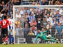 Brighton & Hove Albion's Pascal Gross converts from the penalty spot against Manchester United's David de Gea on August 19, 2018