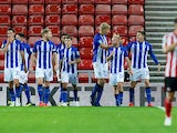 Sheffield Wednesday midfielder Adam Reach celebrates with teammates after scoring during his side's EFL Cup clash with Sunderland on August 16, 2018