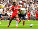 Fulham's Timothy Fosu-Mensah challenges Tottenham Hotspur's Harry Kane on August 18, 2018
