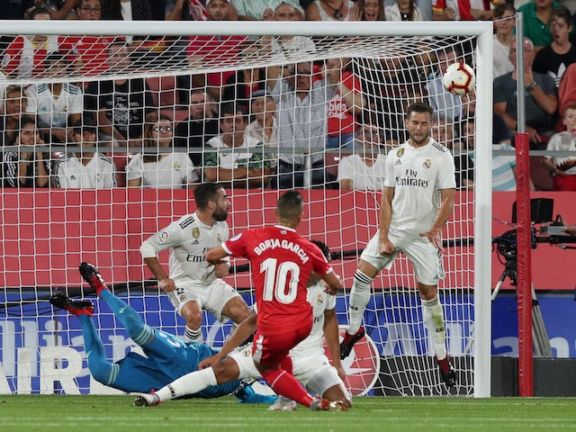 Girona forward Borja Garcia scores the opening goal of his side's La Liga clash with Real Madrid on August 26, 2018