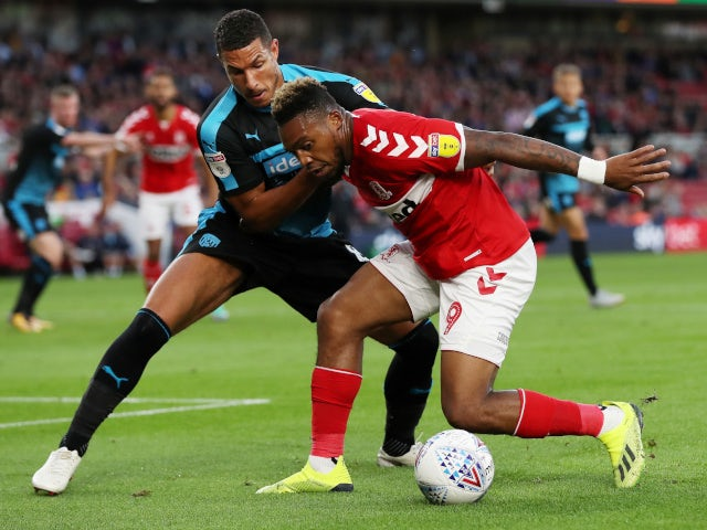 Middlesbrough's Britt Assombalonga in action with West Bromwich Albion's Jake Livermore on August 24, 2018