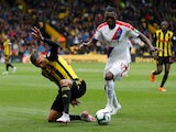 Christian Benteke and Jose Holebas in action during the Premier League game between Watford and Crystal Palace on August 26, 2018