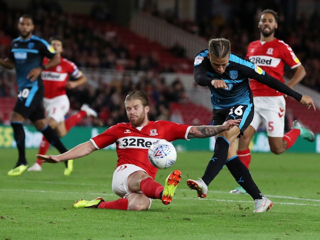 Middlesbrough midfielder Adam Clayton blocks an effort from West Bromwich Albion striker Dwight Gayle during their Championship clash on August 24, 2018