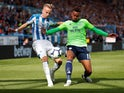 Huddersfield Town's Florent Hadergjonaj in action with Cardiff City's Josh Murphy during their Premier League clash on August 25, 2018