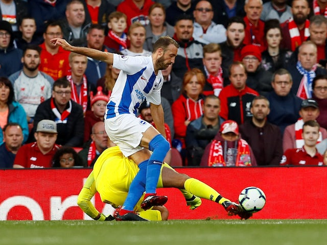 Brighton & Hove Albion striker Glenn Murray puts Liverpool goalkeeper Alisson Becker under pressure during their Premier League clash on August 25, 2018