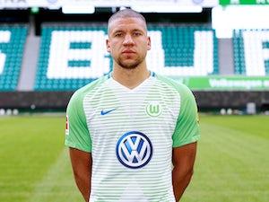 Jeffrey Bruma poses for his Schalke headshot on October 24, 2017