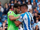 Huddersfield Town captain Jonathan Hogg clashes with Cardiff City midfielder Harry Arter during their Premier League match on August 25, 2018
